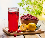 Ice cold drink glass with raspberry and lemon cocktail . Royalty Free Stock Image