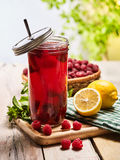Ice cold drink jar glass with raspberry and lemon cocktail . Stock Images