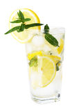 Ice cold fresh lemonade. A view of a cold, refreshing, tasty glass of lemonade with lemon slices and mint leave garnish Stock Photos