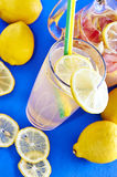 Ice cold lemonade in a glass with pithcer Royalty Free Stock Photos