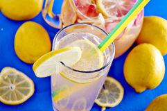Ice cold lemonade in a glass with pithcer Royalty Free Stock Photo