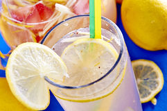 Ice cold lemonade in a glass with pithcer Stock Photo