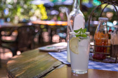 Ice cold lemonade served with mint leaves Royalty Free Stock Images