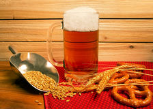 Ice cold mug of beer with pretzels and barley Stock Images