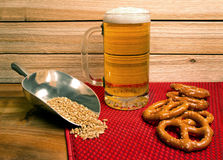Ice cold mug of beer with pretzels Stock Images