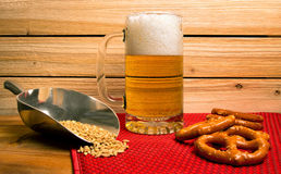 Ice cold mug of beer with pretzels Royalty Free Stock Images