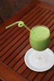 Ice cold refreshing green smoothie in a glas with  Royalty Free Stock Photos