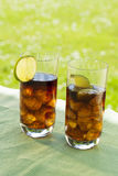 Ice cold summer drinks in sunlight garden Royalty Free Stock Photography