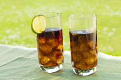 Ice cold summer drinks in sunlight garden Stock Photos
