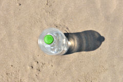 Ice cold unlabelled bottle of refreshing water standing upright Stock Image