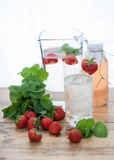 Ice cold water. And strawberry Stock Photos