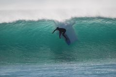 Ice Cool. Surfer drops into a crystal blue wave, Noordhoek, cape town Stock Photos