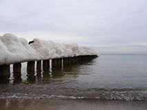 Ice-covered breakwater Stock Image