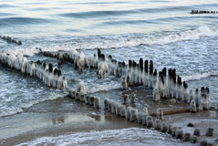 Ice-covered breakwaters. At dawn. Baltic sea, Zelenogradsk, Russia Royalty Free Stock Photo
