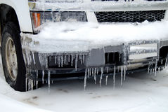 Icicle covered car Stock Photos