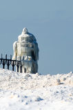 Ice covered light house royalty free stock photo