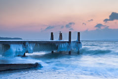 Ice covered pier Royalty Free Stock Photos