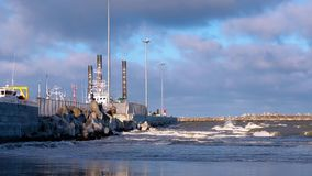 Ice covered pier with ship after storm. Blue sky with white clouds sanctified sun stock video