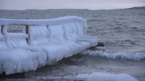 Ice covered pier by the stormy Baltic Sea in Helsinki, Finland stock video footage