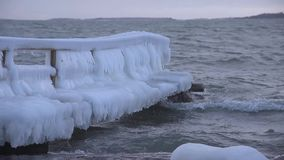 Ice covered pier by the stormy Baltic Sea in Helsinki, Finland stock footage