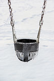 Ice Covered Playground Swing Seat Royalty Free Stock Images