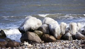 Danish coastline winter landscape with ice on the rocks.. stock photos