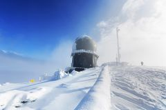 Ice-covered screen weather station, high on mountain-top Royalty Free Stock Photography