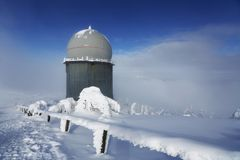 Ice-covered screen weather station, high on mountain-top Stock Photography