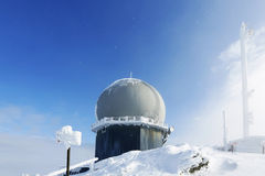 Ice-covered screen weather station, high on mountain-top Royalty Free Stock Images