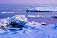 Ice-covered sea. Winter sea ice-covered, at sunset Stock Photo