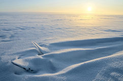 Ice covered with snow. Fragments of ice covered with snow on the coast of the Gulf of Finland Stock Images