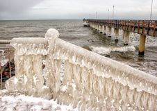 Ice covered staircase on the beach Stock Photo