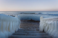 Ice-covered staircase to the sea Royalty Free Stock Photo