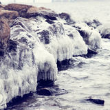 Ice-covered stones in water Stock Photography