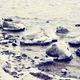 Ice-covered stones in water Royalty Free Stock Images
