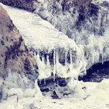 Ice-covered stones in water Royalty Free Stock Photo