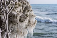 Ice covered tree branch handing over Lake Michigan at Cave Point Park, Door County , Wisconsin. Ice covered tree at Cave Point Park in Wisconsin in winter stock photos