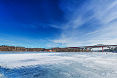 Ice covered water and the bridge over to Stockholm Stock Photo