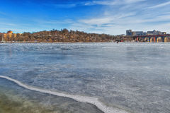 Ice covered water in Stockholm. With view over Tanto from Långholmen Stock Photo