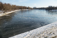 The ice cracked on the pond in November. Moscow stock photo