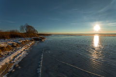 Ice with cracks. At the coast of the lake on a winter decline Stock Photos