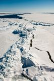 Ice cracks in the sea. Cracked ice on the sea in front of the ship Royalty Free Stock Photo