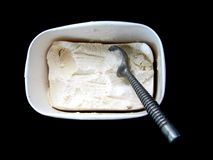 Ice cream. Metal old fashioned ice cream scoop in a tub of vanilla ice cream Stock Photography