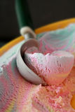 Ice cream. Colorful Ice cream scoop out from a container stock photography