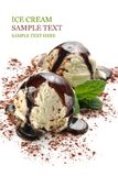 Ice cream. Two ice cream scoops with chocolate sauce and mint Stock Images
