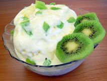 Ice-cream. With kiwi fruits in bowl Royalty Free Stock Photography