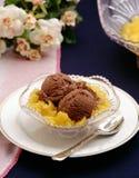 Ice cream. Chocolate ice cream over peaches stock photo