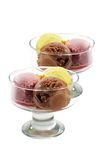 Ice-cream. In spheres with chocolate, a cherry and a lemon on a white background Stock Images
