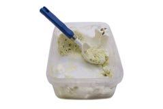 Ice-cream. Half-eaten ice-cream on white background Royalty Free Stock Image
