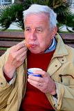 Ice cream. Elderly man eating ice cream Stock Images